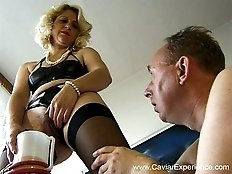 Disgusting mama pouring piss on her lover